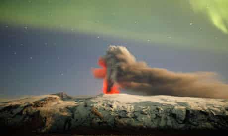 Northern lights illuminate the plume of ash above Eyjafjallajökull