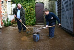 Cornwall Floods Update: Rob and Edward Rusbridge, clean up after flooding in Lostwithiel, Cornwall