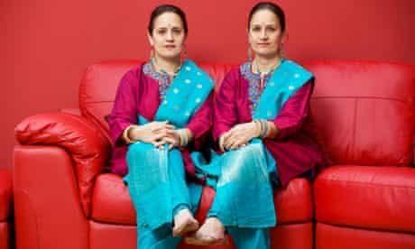 Twin artists Rabindra and Amrit Singh at home in Bidston, Wirral.