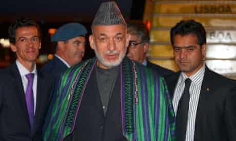 The Afghan president, Hamid Karzai, arrives in Lisbon ahead of the Nato summit
