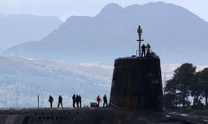 A Vanguard class nuclear submarine leaves Faslane naval base in Scotland
