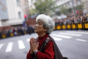 Shanghai Memorial: A mourner prays for victims killed in an apartment block blaze