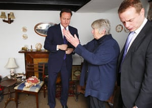 Cameron Visit Cornwall: David Cameron and local MP Steven Gilbert talk with Val Paige in her home