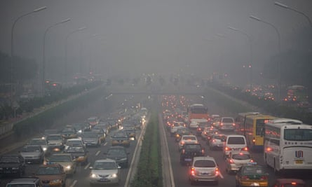Traffic clogs Beijing as a heavy haze hangs over the city