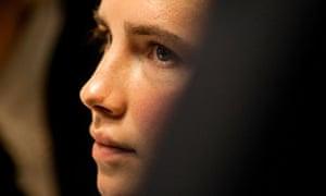 American university student Knox looks on