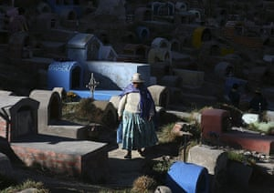 """All Saints: A woman walks at the """"Llamita"""" cemetery during All Saints Day"""