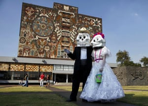 All Saints: Mexico City, Mexico: A couple wear oversized skull