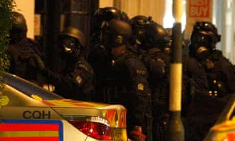 Armed police gather to end a stand-off with an armed man in King's Road, in west London