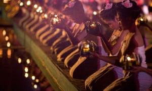 Women say prayers before releasing their krathongs