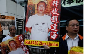 Pro-democracy campaigners hold picture of Zhao Lianhai