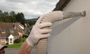 Installing cavity wall insulation, one of the benefits of householders signing up to the green deal