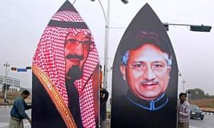 Pakistani workers prepare a billboard di