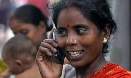 Slum dweller uses mobile