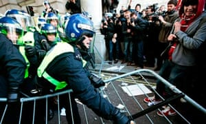 Police clash with students in London during a demonstration over tuition fees