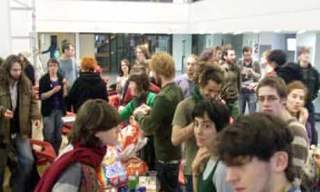 Edinburgh students tuck into food supplies last night during their occupation of Appleton Tower