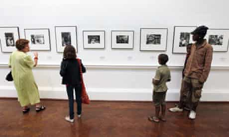 People look at photographs by photojournalist Ernest Cole at the Johannesburg Art Gallery.