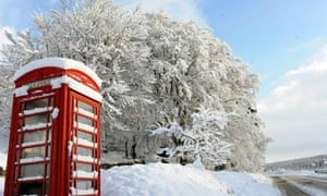 Snow covers a telephone box in Crathie in Scotland