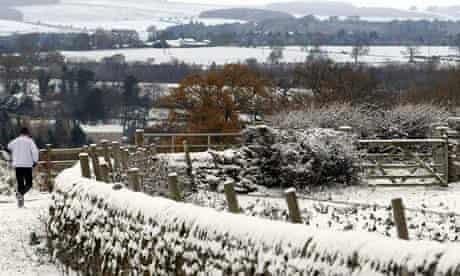 A man runs through the snow near Hexham