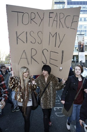 Student Protest Slogans : Protesters march during a demonstration in Manchester