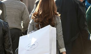 Woman on Oxford Street with a Prada shopping bag