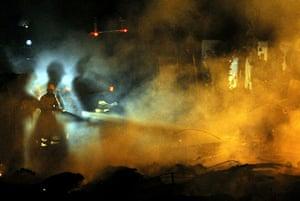 24 hours in pictures: cargo plane crash in karachi