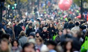 Chritsmas shoppers walk along Oxford st in central London