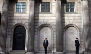 People outside the Bank of England, in central London's City financial district, Nov. 15, 2010