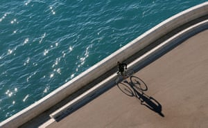 24 hours in picrtures: A cyclist takes a rest on the Promenade des Anglais in Nice