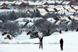 Snow and freezing hits uk: Children playing in the heavy snowfall
