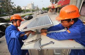 Year in Climate: CHINA-JIANGSU-NANTONG-TELEPHONE BOOTH-SOLAR PHOTOVOLTAIC (CN)