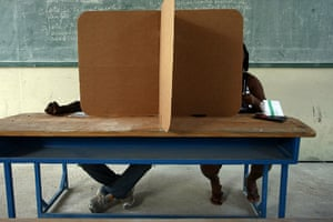 Haiti Elections: Two Haitians prepare their votes at the