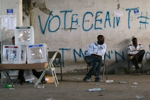 Haiti Elections: Poll workers sit idle next to ballot boxes