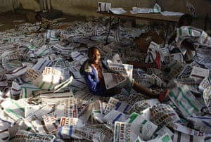 Haiti Elections: A Haitian child plays with ballots