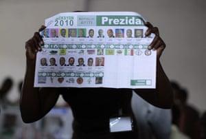 Haiti Elections: A Haitian electoral worker shows a presidential ballot
