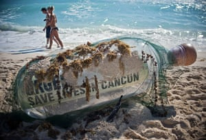 Year in Climate: COP16: a bottle with a message from Oxfam activists, Cancun