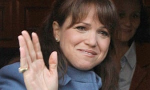 Christine O'Donnell waves after casting her vote in the 2010 US midterms