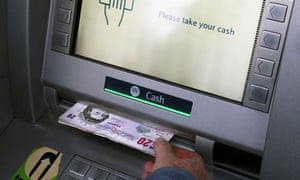 Money being withdrawn from a cash machine (ATM)