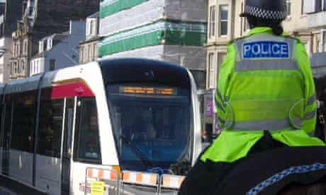 Police horse passes the static display tram on Edinburgh's Princes Street