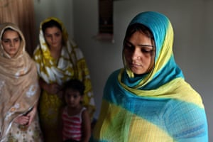 Karachi Pakistan: Sisters mourn the death of their father and two brothers