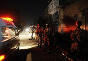 Karachi Pakistan: Paramilitary soldiers cordon off the site following gunmen attacks