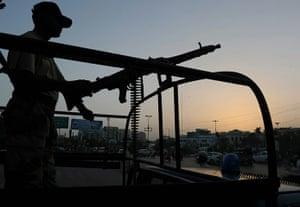Karachi Pakistan: A Pakistani paramilitary soldier stands guard on a street in Karachi