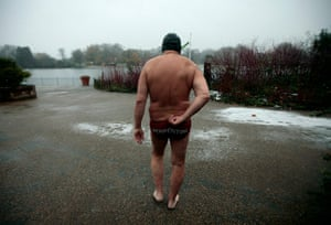 24 hours in pictures: Man goes swimming in freezing waters of the Serpentine Lido in Hyde Park