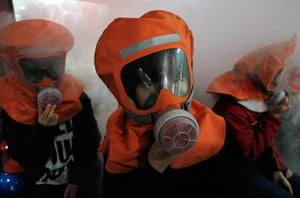 24 hours in pictures: South Korean students participate in an anti-chemical attack drill in Seoul