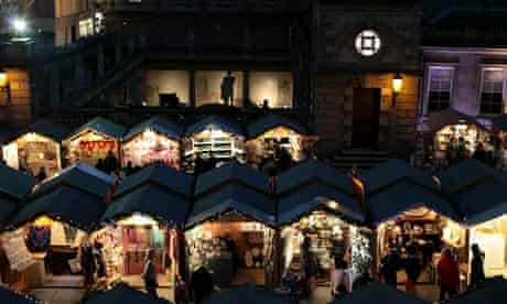 Christmas shoppers browse the offerings at the Bath Christmas Market