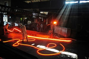 From the agencies: Steel workers are pictured at Ittehad Steel Mill Islamabad