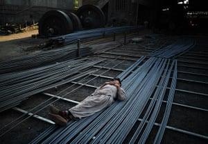 From the agencies: A steel worker sleeps on steel rods