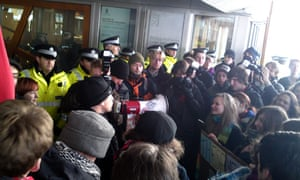 Police protect the entrance to Holyrood