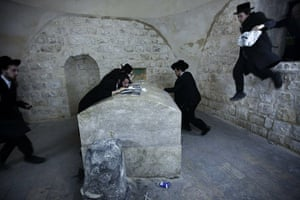 24 hours in pictures: Ultra Orthodox Jewish men rush to pray at the renovated Tomb of Joseph