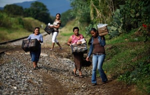 24 hours in pictures: Mexican women carry food to give to Honduran immigrants