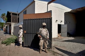 24 hours in pictures: Soldiers guard outside a warehouse where a tunnel near the US-Mexico border